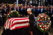 Cindy McCain touches the casket of former Senator John McCain in the Capitol Rotunda where he will lie in state at the U.S. Capitol, in Washington, DC on Friday, August 31, 2018. McCain, an Arizona Republican, presidential candidate and war hero died August 25th at the age of 81. He is the 31st person to lie in state at the Capitol in 166 years.    Photo by Kevin Dietsch/UPI