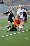 Goal keeper pounces on the ball