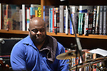CORAL GABLES, FL - FEBRUARY 06: Kevin Sharpe of The Avery Sharpe Trio band perform during a discussion and book signing of Jasmine Guy book 'Afeni Shakur: Evolution of a revolutionary' at Books and Books on Friday February 6, 2015 in Coral Gables, Florida. (Photo by Johnny Louis/jlnphotography.com)