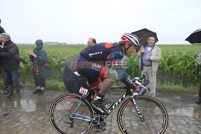 Riders including Sylvain Chavanel (FRA) IAM Cycling tackle the1st cobbled sector 9 from Gruson to Crossroads de l'Arbe during Stage 5 of the 2014 Tour de France running 155.5km from Ypres to Arenberg. 9th July 2014.<br /> Picture: Eoin Clarke www.newsfile.ie