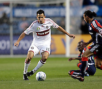 Chicago Fire midfielder Marco Pappa (16) makes a move against New England midfielder Kevin Alston (30).  The Chicago Fire tied the New England Revolution 1-1 at Toyota Park in Bridgeview, IL on May 9, 2009.