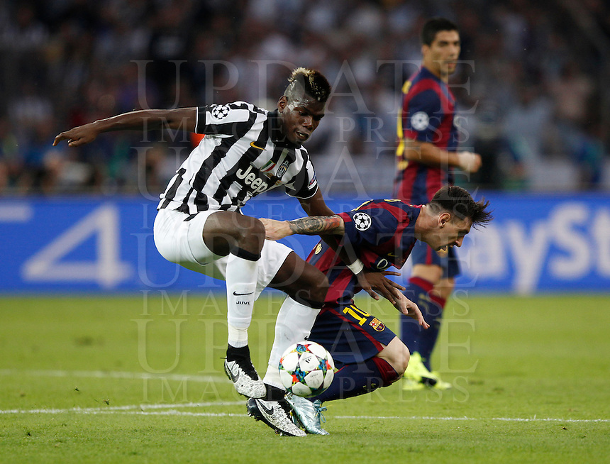 Calcio, finale di Champions League Juventus vs Barcellona all'Olympiastadion di Berlino, 6 giugno 2015.<br /> Juventus' Paul Pogba, left, and FC Barcelona's Lionel Messi fight for the ball during the Champions League football final between Juventus Turin and FC Barcelona, at Berlin's Olympiastadion, 6 June 2015.<br /> UPDATE IMAGES PRESS/Isabella Bonotto