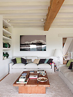 The sitting room has exposed ceiling beams which give a rustic edge whilst the neutral decoration creates a fresh and airy feel.