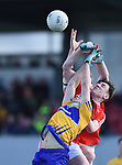 Gearoid O Brien of Clare in action against Fergal Donohoe of Louth during their national League game in Cusack Park. Photograph by John Kelly.