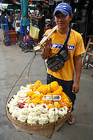 Chatuchak Weekend Market Garland Vendor at and one of the largest markets in the world covering over 35 acres and containing more than 5000 stalls - not counting wandering vendors and street entertainers. Most stalls are only open on Saturdays and Sundays. The market offers a wide variety of products including household items, clothing, Thai handicrafts, religious artifacts, collectibles, foods and live animals.