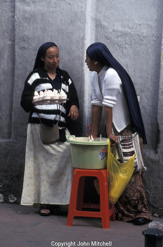 Young woman ice cream vendors in old Quito, Ecuador