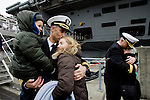 USS John C. Stennis Commanding Officer, Capt. Ronald Reis hugs his family, (L),  while Rear Adm. Craig Faller, strike group commander, hugs his wife Martha after the 1,092-foot-long aircraft carrier pulled into it's homeport on on March, 2, 2012 at Naval Station Kitsap in Bremerton, WA.  The carrier and it's 3,200 crew members arrived Friday after spending a six-month deployment in support of  Middle East operations.   ©2012 Jim Bryant Photo. All Rights Reserved.