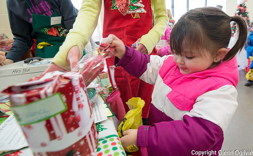 Two-year-old Lily Mae Rawcliffe, the daughter of Jessica and Zon bags her presents at the check-out  <br /> <br /> Pathways 8th annual Secret Santa Shop and saw 800 kids buy 4,000 wrapped gifts last year, raising $20,000. One of the major fund raisers. Money is directed at Programming and Services. Start shopping Boxing Day and continue throughout the year with wrapping done during the summer. No parents allowed. A small army of volunteers help kids with shopping and paying for gifts at the cashier. All brand new gifts are  priced between $3-$10. Also cookie decorating, a Christmas Cafe and treats. It will be held again next weekend.