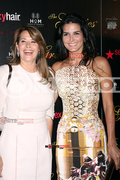 Lorraine Bracco and Angie Harmon at the Alliance for Women in Media Foundation's 37th Annual Gracie National Awards at The Beverly Hilton Hotel on May 22, 2012 in Beverly Hills, California. © mpi28/MediaPunch Inc.