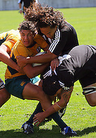 Liaki Moli tries to tackle Mark Swanepoel during the International rugby match between New Zealand Secondary Schools and Suncorp Australia Secondary Schools at Yarrows Stadium, New Plymouth, New Zealand on Friday, 10 October 2008. Photo: Dave Lintott / lintottphoto.co.nz