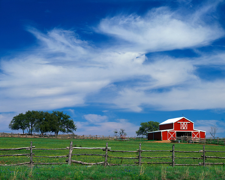 Cloud formations over a barn on a ranch in the Hill Country; Llano County, TX