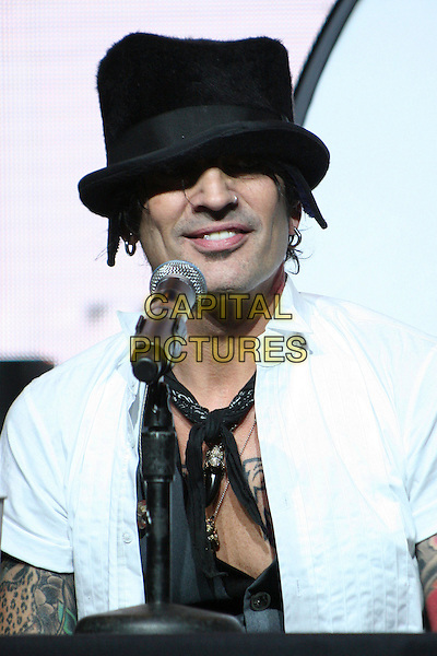 "TOMMY LEE of MOTLEY CRUE.Motley Crue Press Conference Announcing ""Crue Fest"" 2008 Concert Series at Avalon Hollywood, Hollywood, California, USA, 15 April 2008..portrait headshot band music black hat scarf tie white shirt tattoos microphone .CAP/ADM/BP.©Byron Purvis/Admedia/Capital PIctures"