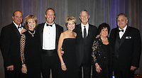 NWA Democrat-Gazette/CARIN SCHOPPMEYER Mark and Sara Moses (from left), Tony and Mary Beth Sherman, Pete and Shirley Esch and Kent Whillock help support Mercy Health Foundation at the O Night Divine Charity Ball on Dec. 3 at the John Q. Hammons Center in Rogers. The family was honored as the foundation's Family of the Year at the fundraiser.