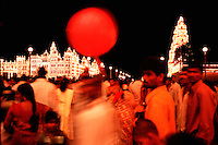 A crowd gathers near the Mysore Palace decorated with lights in celebration of the Indian festival of Dasara. Mysore, India.
