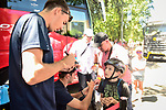 Christophe Laporte (FRA) Cofidis signs autographs for young fans ahead of the race during Stage 3 of the 2018 Tour de France a Team Time Trial running 35.5km from Cholet to Cholet (35,5km, France. 9th July 2018. <br /> Picture: ASO/Pauline Ballet | Cyclefile<br /> All photos usage must carry mandatory copyright credit (&copy; Cyclefile | ASO/Pauline Ballet)