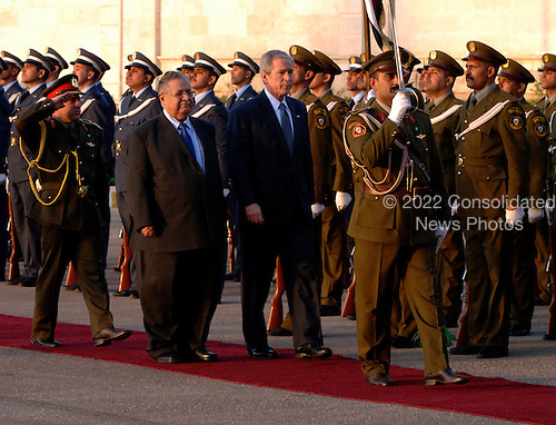 Baghdad, Iraq - December 14, 2008 -- United States President George W. Bush and President Jalal Talabani of Iraq review Iraqi troops Sunday, December 14, 2008 on their way to Salam Palace in Baghad. Bush is on his final visit to Iraq before the end of his second presidential term to meet with Iraqi leaders and sign a ceremonial copy of the security agreement. .Credit: Kristin Fitzsimmons - U.S. Navy via CNP