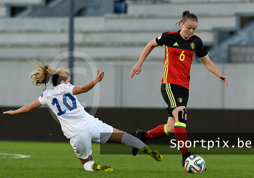 20160412 - LEUVEN ,  BELGIUM : Belgian Tine De Caigny (6) pictured avoiding the tackling Estonian Aljona Sasova (10)  during the female soccer game between the Belgian Red Flames and Estonia , the fifth game in the qualification for the European Championship in The Netherlands 2017  , Tuesday 12 th April 2016 at Stadion Den Dreef  in Leuven , Belgium. PHOTO SPORTPIX.BE / DAVID CATRY