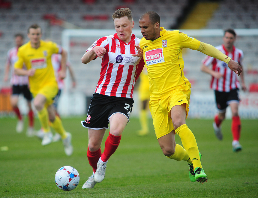 Lincoln City&rsquo;s George Maris vies for possession with Woking's Jake Caprice<br /> <br /> Photographer Andrew Vaughan/CameraSport<br /> <br /> Football - Vanarama National League - Lincoln City v Woking - Saturday 23rd April 2016 - Sincil Bank - Lincoln <br /> <br /> &copy; CameraSport - 43 Linden Ave. Countesthorpe. Leicester. England. LE8 5PG - Tel: +44 (0) 116 277 4147 - admin@camerasport.com - www.camerasport.com