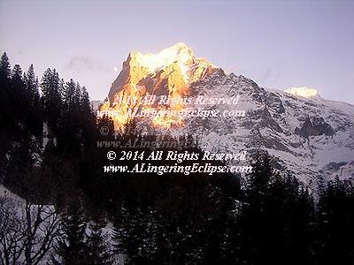 Skiing in Grindelwald Switzerland Moon Rising Next to Peaks