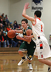 Manogue's Gray Reid drives past Douglas' Connor Hughes during a boys basketball game between Bishop Manogue and Douglas High in Minden, Nev., on Thursday, Dec. 22, 2011..Photo by Cathleen Allison