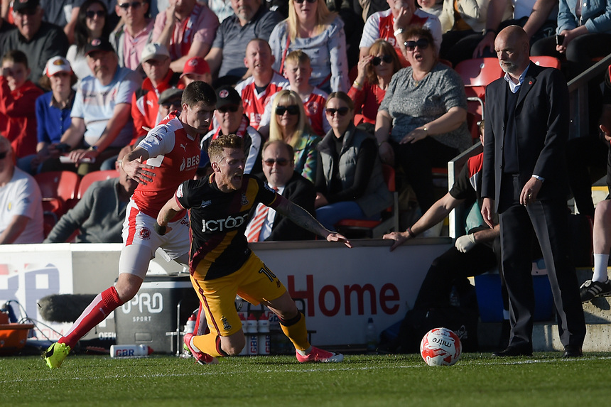 Bradford City's Rory McArdle goes to ground under pressure from Fleetwood Town's Bobby Grant<br /> <br /> Photographer Terry Donnelly/CameraSport<br /> <br /> The EFL Sky Bet League One Play-Off Second Leg - Fleetwood Town v Bradford City - Sunday 7th May 2017 - Highbury Stadium - Fleetwood<br /> <br /> World Copyright &copy; 2017 CameraSport. All rights reserved. 43 Linden Ave. Countesthorpe. Leicester. England. LE8 5PG - Tel: +44 (0) 116 277 4147 - admin@camerasport.com - www.camerasport.com