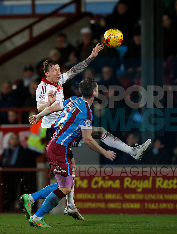 Martyn Woolford of Sheffield Utd heads the ball over Scott Wiseman of Scunthorpe Utd  - English League One - Scunthorpe Utd vs Sheffield Utd - Glandford Park Stadium - Scunthorpe - England - 19th December 2015 - Pic Simon Bellis/Sportimage