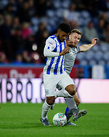 Huddersfield Town's Elias Kachunga is tackled by Lincoln City's Michael O'Connor<br /> <br /> Photographer Andrew Vaughan/CameraSport<br /> <br /> The Carabao Cup First Round - Huddersfield Town v Lincoln City - Tuesday 13th August 2019 - John Smith's Stadium - Huddersfield<br />  <br /> World Copyright © 2019 CameraSport. All rights reserved. 43 Linden Ave. Countesthorpe. Leicester. England. LE8 5PG - Tel: +44 (0) 116 277 4147 - admin@camerasport.com - www.camerasport.com