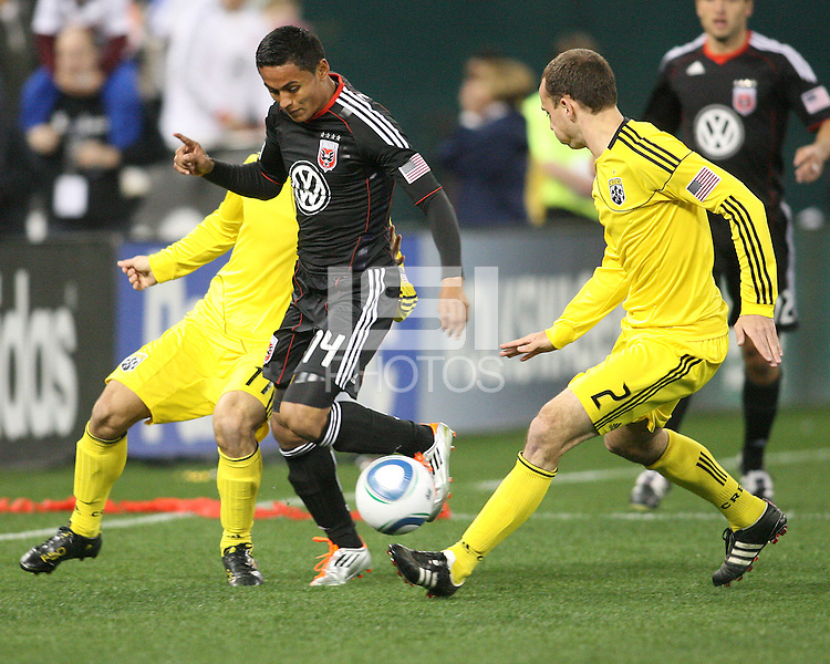 Andy Najar#14 of D.C. United tries to get past Rich Balchan#2 of the Columbus Crew during the opening match of the 2011 season at RFK Stadium, in Washington D.C. on March 19 2011.D.C. United won 3-1.