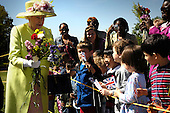 """Queen Elizabeth greets children on her walk from NASA?s Goddard Space Flight Center mission control to a reception in the center?s main auditorium, Tuesday, May 8, 2007, in Greenbelt, Md.  Queen Elizabeth II and her husband, Prince Philip, Duke of Edinburgh, visited the NASA Goddard Space Flight Center as one of the last stops on their six-day United States visit. Photo Credit: """"NASA/Bill Ingalls"""""""