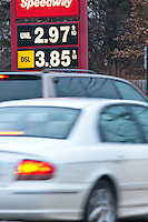 Gasoline prices dropped below $3 a gallon for the first time in more than a year in the last week of shopping before Christmas. Drivers were greeted with signage marking the lower prices.