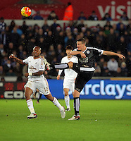 Danny Drinkwater of Leicester City  \kicks the ball away during the Barclays Premier League match between Swansea City and Leicester City at the Liberty Stadium, Swansea on December 05 2015