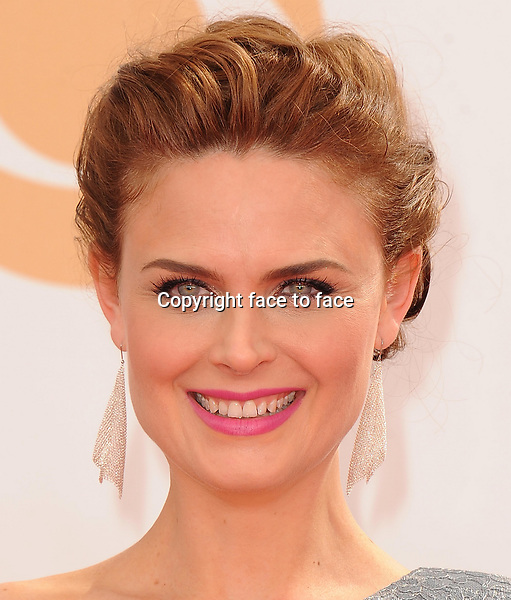 Emily Deschanel arrives at the 65th Primetime Emmy Awards at Nokia Theatre on Sunday Sept. 22, 2013, in Los Angeles.<br />