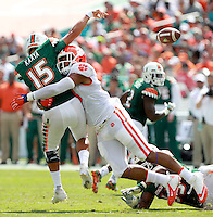 Clemson defensive tackle Kevin Dodd (98) hits Miami quarterback Brad Kaaya (15) as he attempts a pass in the 1st quarter in Miami Gardens, Fla. on Saturday.