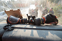 Feuerwehr in Qamishli, Rojava/Syrien.<br /> Von sieben Feuerwehr-Fahrzeugen die der YPG-Regierung in Qamishli zur Verfuegung stehen, ist nur eines funktionstuechtigt. Fuenf Fahrzeuge sind mit vorhandenen Mitteln nicht zu reparieren - Motorschaden, unbenutzbare Fahrerkabinen, defekte Stromleitungen.<br /> Zusaetzlich zumden Augaben der Feuerwehr muessen die 12 Feuerwehrmaenner - je 3 von ihnen arbeiten in 24-Stundenschichten - auch noch Wasser in Stadtteile ohne Wasserversorgung verteilen.<br /> Im Bild: Alte Gasmasken mit verbrauchten Filtern. Die Feuerwehrleute benutzen sie dennoch bei Braenden um sich vor Gasen zu schuetzen.<br /> 15.12.2014, Qamishli/Rojava/Syrien<br /> Copyright: Christian-Ditsch.de<br /> [Inhaltsveraendernde Manipulation des Fotos nur nach ausdruecklicher Genehmigung des Fotografen. Vereinbarungen ueber Abtretung von Persoenlichkeitsrechten/Model Release der abgebildeten Person/Personen liegen nicht vor. NO MODEL RELEASE! Nur fuer Redaktionelle Zwecke. Don't publish without copyright Christian-Ditsch.de, Veroeffentlichung nur mit Fotografennennung, sowie gegen Honorar, MwSt. und Beleg. Konto: I N G - D i B a, IBAN DE58500105175400192269, BIC INGDDEFFXXX, Kontakt: post@christian-ditsch.de<br /> Bei der Bearbeitung der Dateiinformationen darf die Urheberkennzeichnung in den EXIF- und  IPTC-Daten nicht entfernt werden, diese sind in digitalen Medien nach §95c UrhG rechtlich geschuetzt. Der Urhebervermerk wird gemaess §13 UrhG verlangt.]