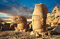 Image of the statues of around the tomb of Commagene King Antochus 1 on the top of Mount Nemrut, Turkey. Stock photos & Photo art prints. In 62 BC, King Antiochus I Theos of Commagene built on the mountain top a tomb-sanctuary flanked by huge statues (8–9 m/26–30 ft high) of himself, two lions, two eagles and various Greek, Armenian, and Iranian gods. The photos show the broken statues on the  2,134 m (7,001 ft)  mountain. 2