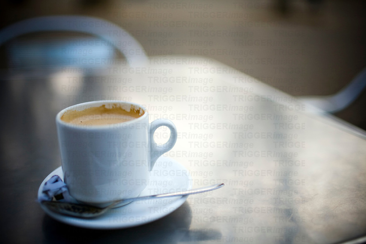 Cup of coffee on a outdoor table, Seville, Spain