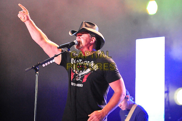 TRACE ADKINS.performs at the 2010 Jamboree In The Hills, Morristown, OH, USA, .15th July 2010..half length arm raised up black cowboy hat t-shirt microphone singing hand country music live on stage concert gig.CAP/ADM/RP.©Ryan Pavlov/AdMedia/Capital Pictures.