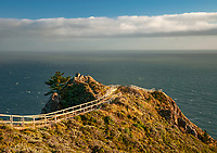 A Highway 1 raodside pull off and walkway gives acces to a viewing platfoirm and stunning views of the Pacific Ocean coast in Marin County, Californnia