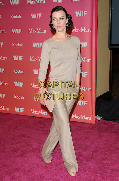 DEBI MAZAR .at The Women in Film 2009 Crystal .and Lucy Awards held at The Hyatt Regency Century Plaza in Century City, California, USA, June 12th 2009                                                                     .full length beige trousers jumper top clutch bag .CAP/DVS.©DVS/RockinExposures/Capital Pictures