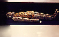 China:   Jade Burial Suit--2000 pieces sewn with gold wire.  Western Han, 100 B.C.
