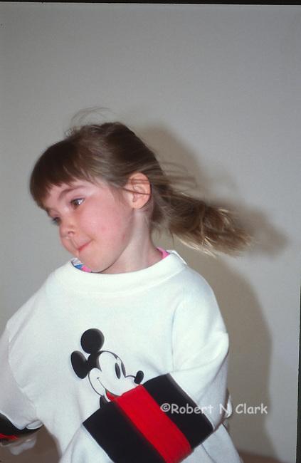 Girl showing off her Mickey sweatshrit