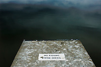 Goose droppings litter the landing at a boat ramp painted with a no fishing sign at Hoover Reservoir.<br />