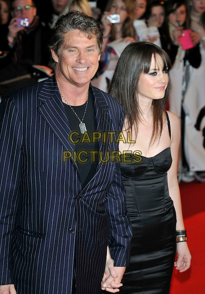 DAVID HASSELHOFF & guest .Arrivals - 2009 Brit Awards, Earls Court, London, England, February 18th 2009..half length blue navy pinstripe suit black bustier dress holding hands.CAP/PL.©Phil Loftus/Capital Pictures