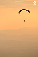 Paragliders flying in tandem at sunset (Licence this image exclusively with Getty: http://www.gettyimages.com/detail/92866135 )
