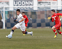 University of Connecticut midfielder Carlos Alvarez (10) at midfield. .NCAA Tournament. With a goal in the second overtime, University of Connecticut (white) defeated University of New Mexico (red), 2-1, at Morrone Stadium at University of Connecticut on November 25, 2012.