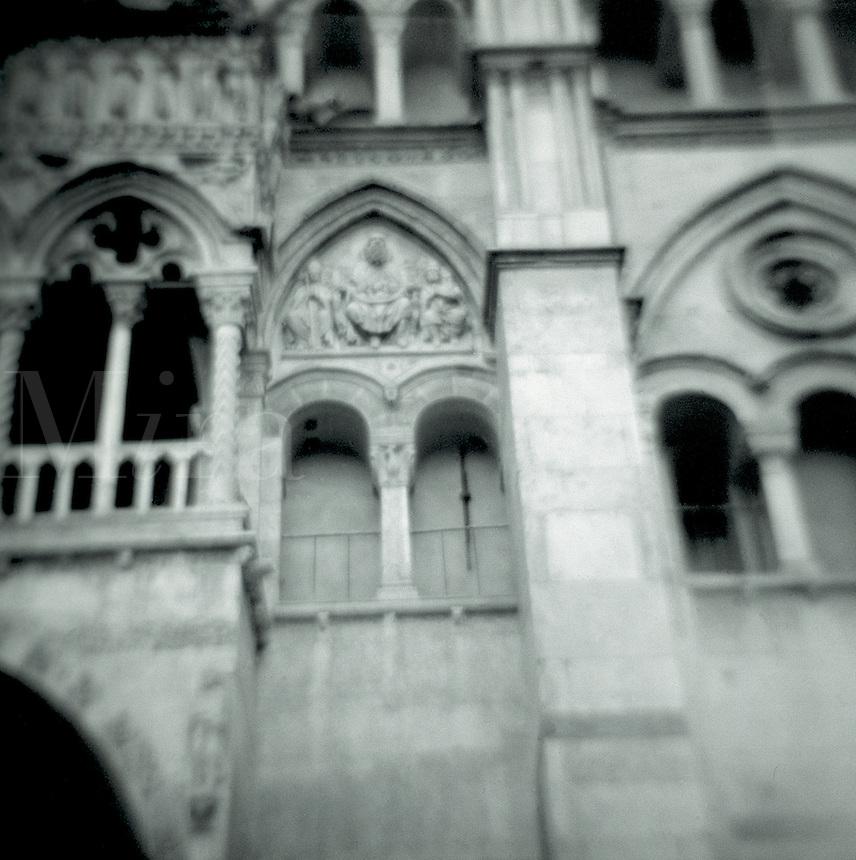 The ornate facade of an Italian building. Italy.