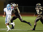 Torrance, CA 10/02/15 - Ari Harris (Carson #14) and Roman Watson (West #6) in action during the Carson-West Torrance CIF varsity football game at West Torrance High School.  Carson defeated West Torrance 34-27.