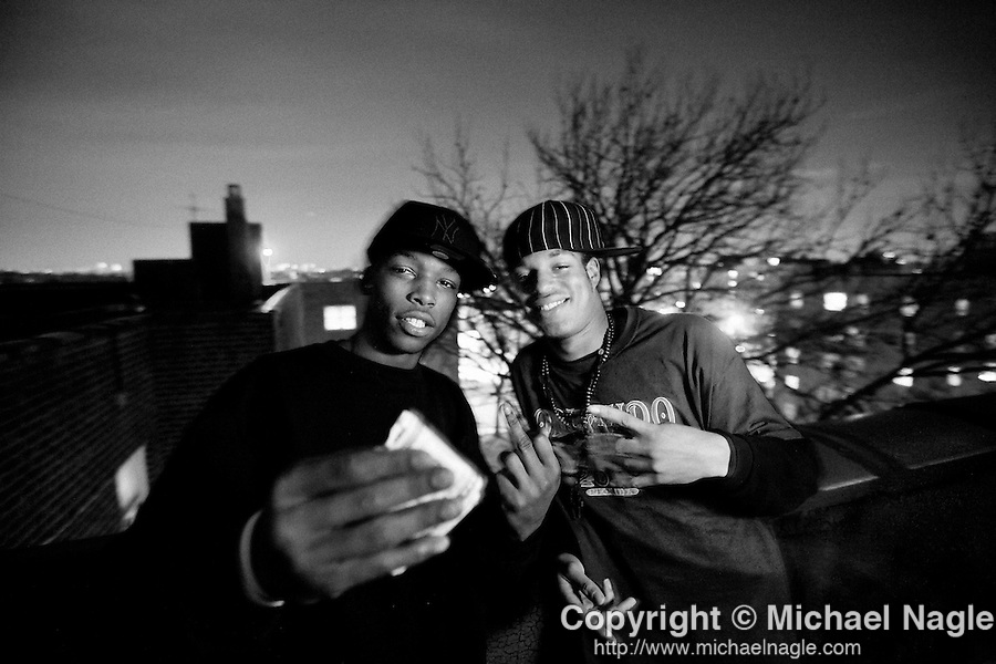 "BROOKLYN -- FEBRUARY 09, 2009:  Jamie ""Kapo Tha Don"" Johnson, 19, (L) and Jaffie Menz, 18, (R), friends of Rapper Jalisa Mioner, 20, pose on the rooftop of one of the buildings in the Sheepshead Bay/Nostrand Houses housing project complex on February 09, 2009 in Brooklyn.  (PHOTOGRAPH BY MICHAEL NAGLE)."