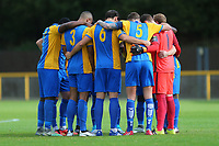 Romford players huddle during Romford vs Hastings United, FA Trophy Football at Ship Lane on 8th October 2017