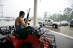 Shane Stiltner sits with an AR 15 and Glock 45 cal in to guard against looters at the Barker GMC as in Houma, Louisiana as Hurricane Gustav passes through September 1, 2008.    (Mark Wallheiser/TallahasseeStock.com)